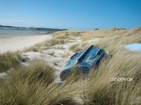 lifestyle image blue boat on beach